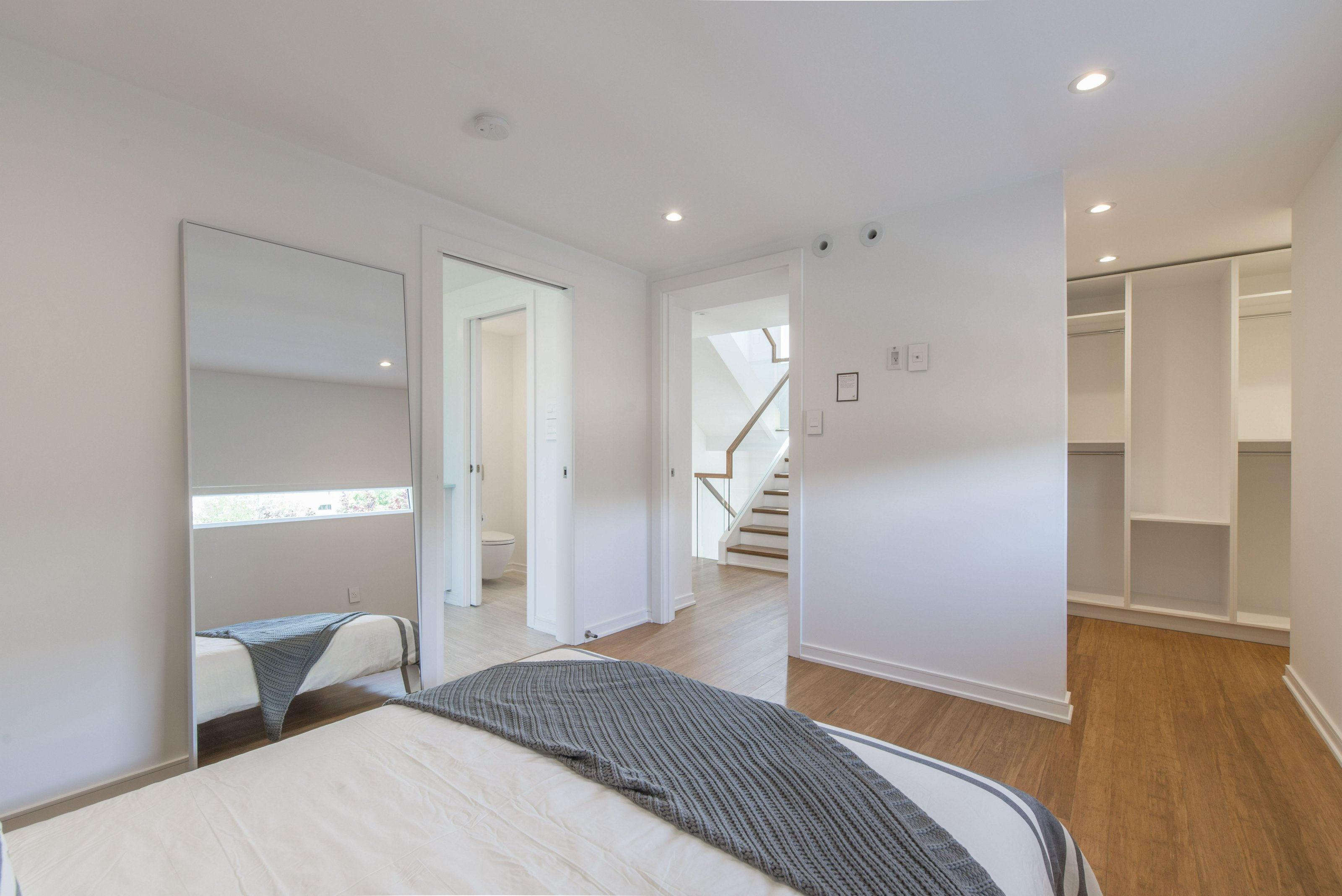 Master bedroom is spacious with a walk-in closet.